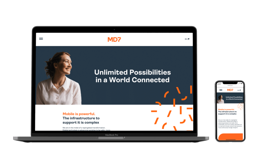 MD7 website shown in MacBook Air and iPhone